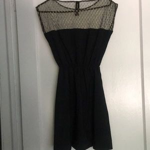 Black dress with mesh gold shoulder section